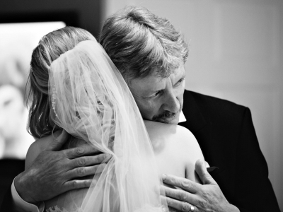father of the bride hugging his daughter on the morning of the wedding