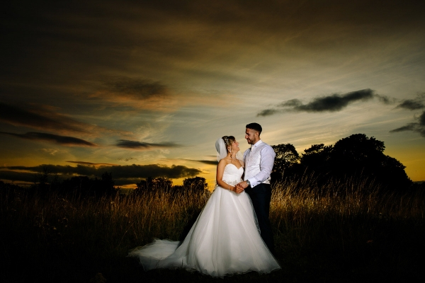 Beautiful evening sunset with the bride and groom at Crabwall Manor in Cheshire