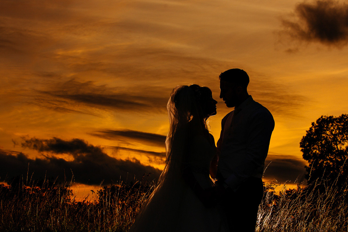 Lovely silhouette of the Bride and Groom during a sunset