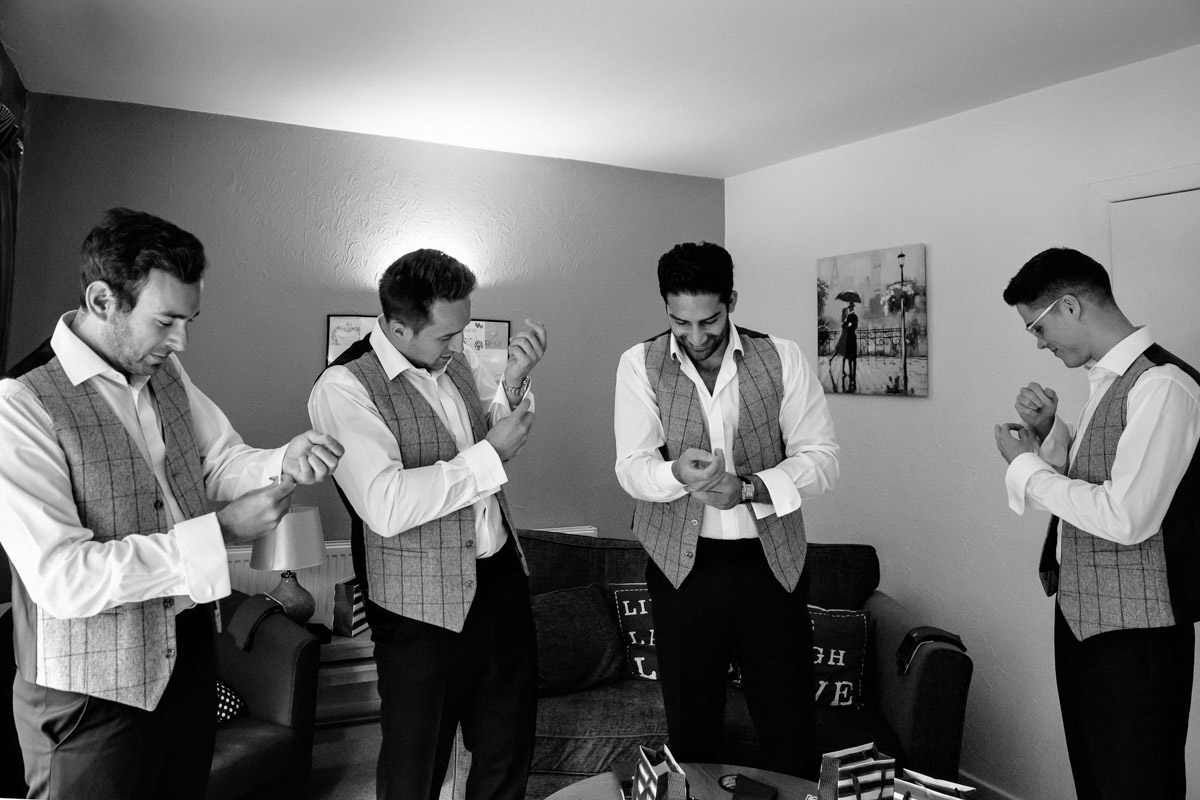 Groom and Groomsmen getting ready the morning of the wedding