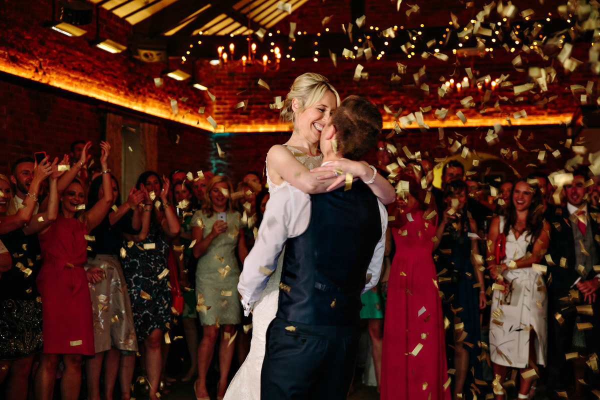 Bride and Groom during their first dance with confetti canons