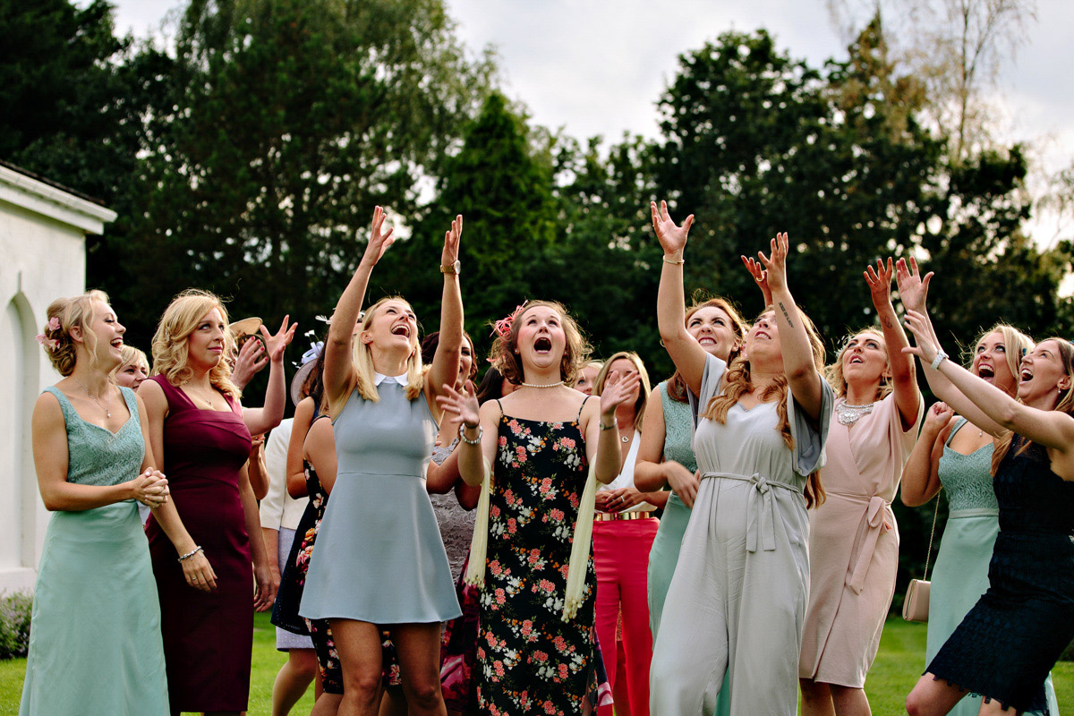 All of the girls waiting to catch the bouquet