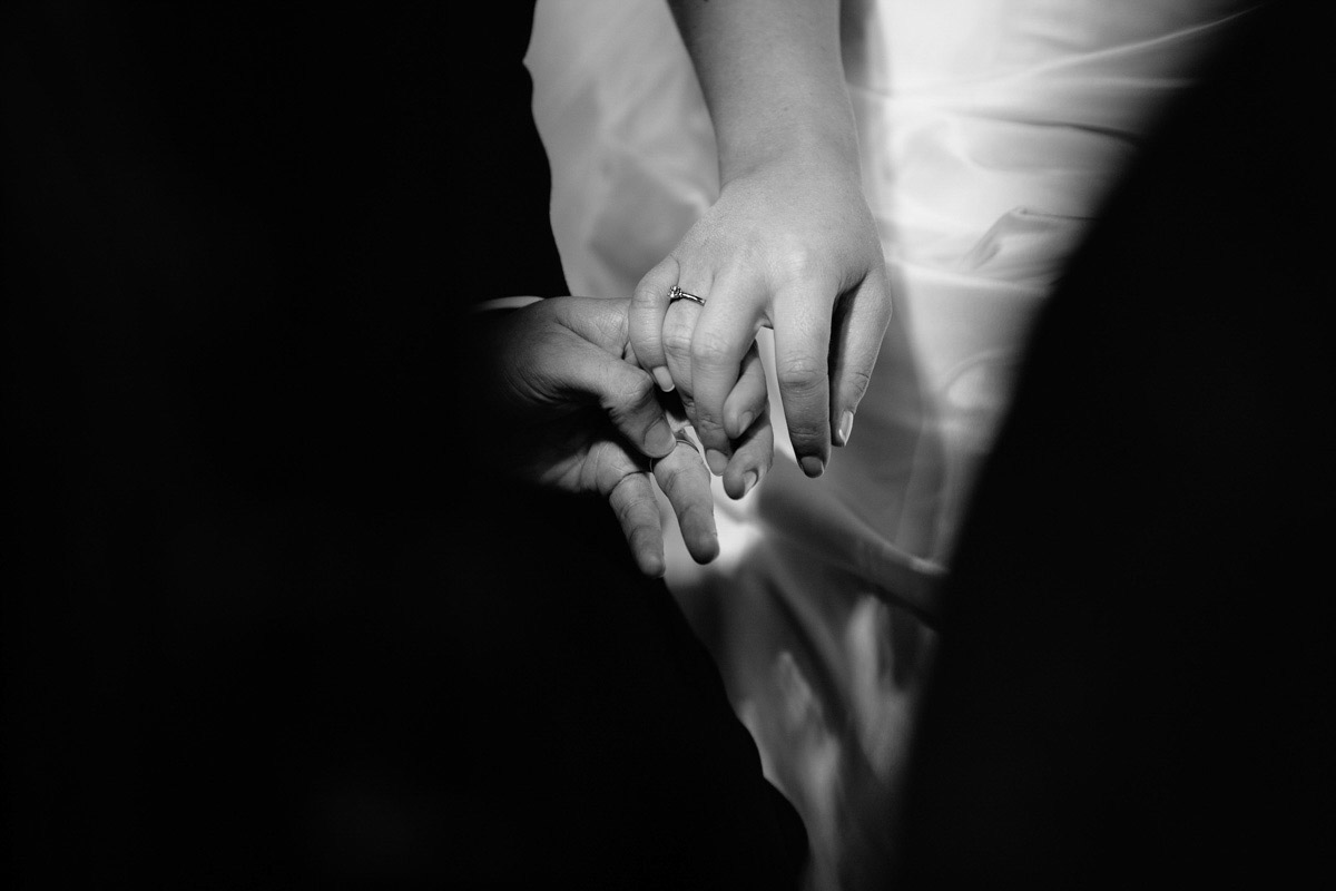 Wedding rings and hands of the bride and groom during the ceremony