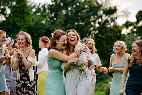 Girls hugging and laughing at the wedding