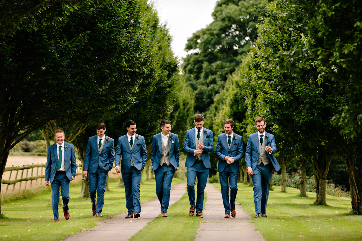 Groom and Groomsmen walking to the wedding before the ceremony