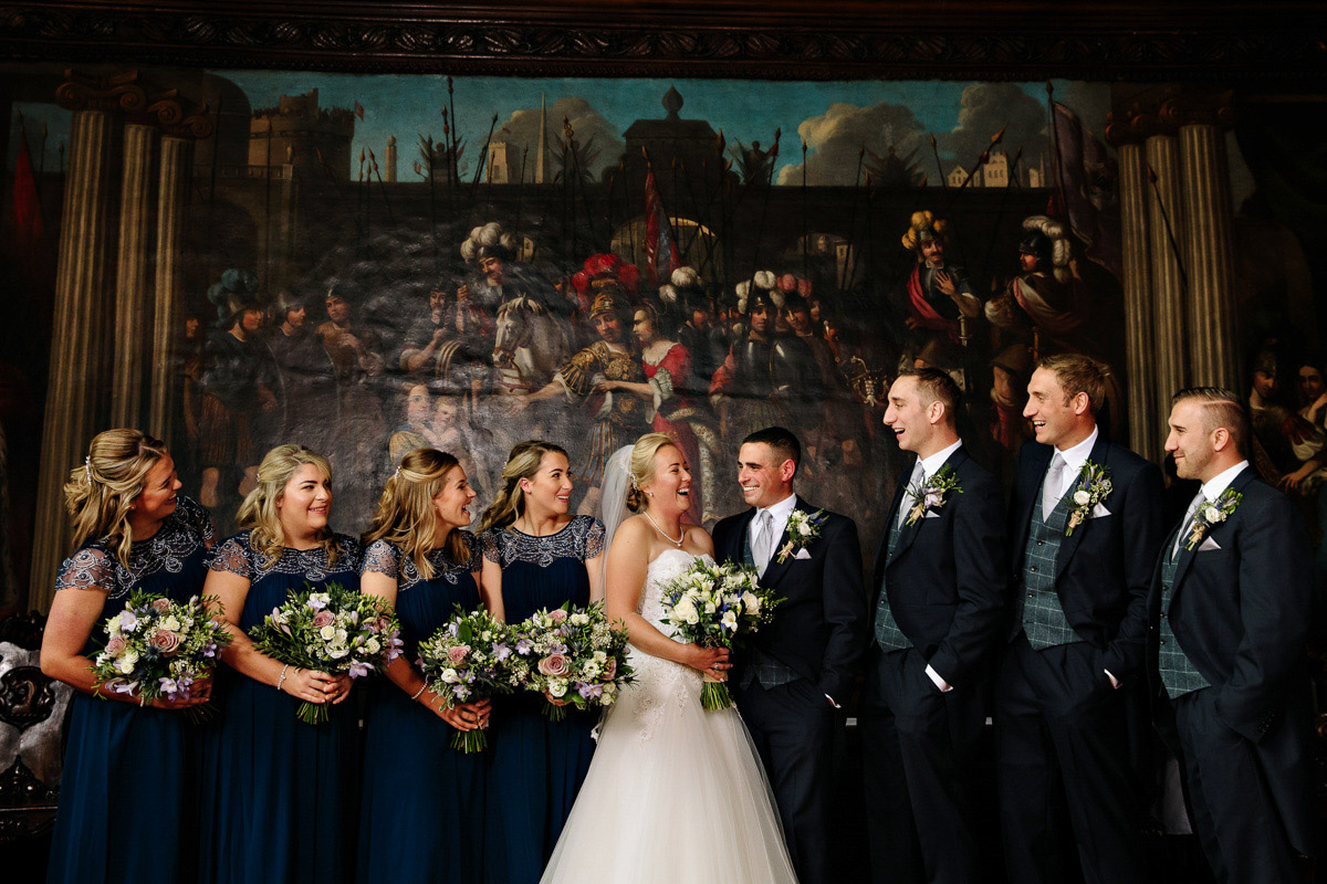 Bride and Groom with the the Bridesmaids and Groomsmen laughing and having fun