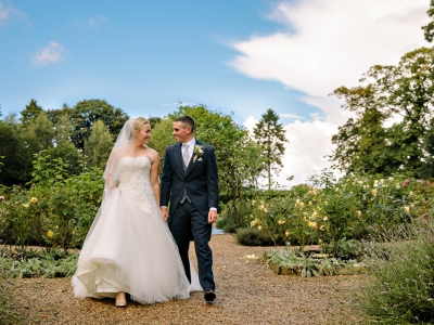 Bride and Groom walking in the garden at Adlington Hall and Gardens in Cheshire