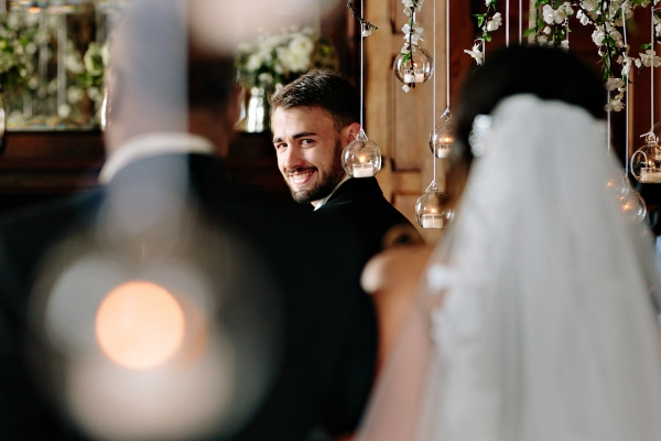 Lovely moment captured of the groom seeing his bride for the first time