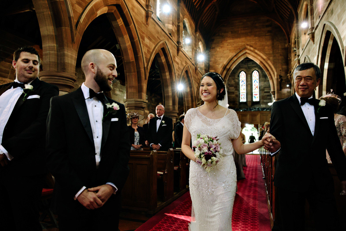 Groom seeing the Bride for the first time in the Church
