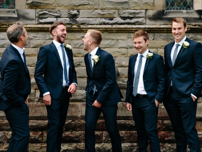 Groom and groomsmen laughing together