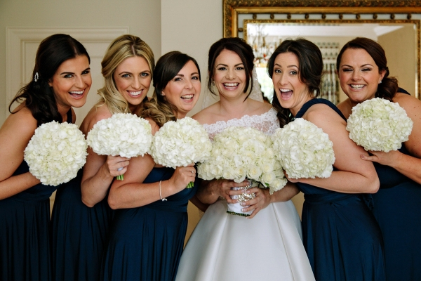 Bride and Bridesmaids laughing together during the bridal preparations