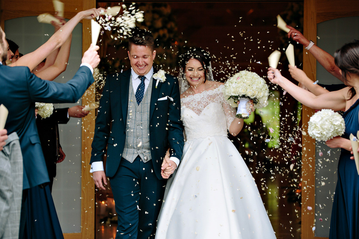 Bride and Groom getting showered in confetti and the ceremony