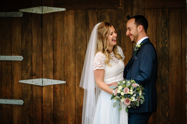 Bride and Groom laughing together at Owen House Barn