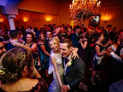 Bride and Groom dancing with all of their guests