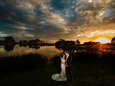 Stuning sunset with the bride and groom at Sandhole Oak Barn in Cheshire