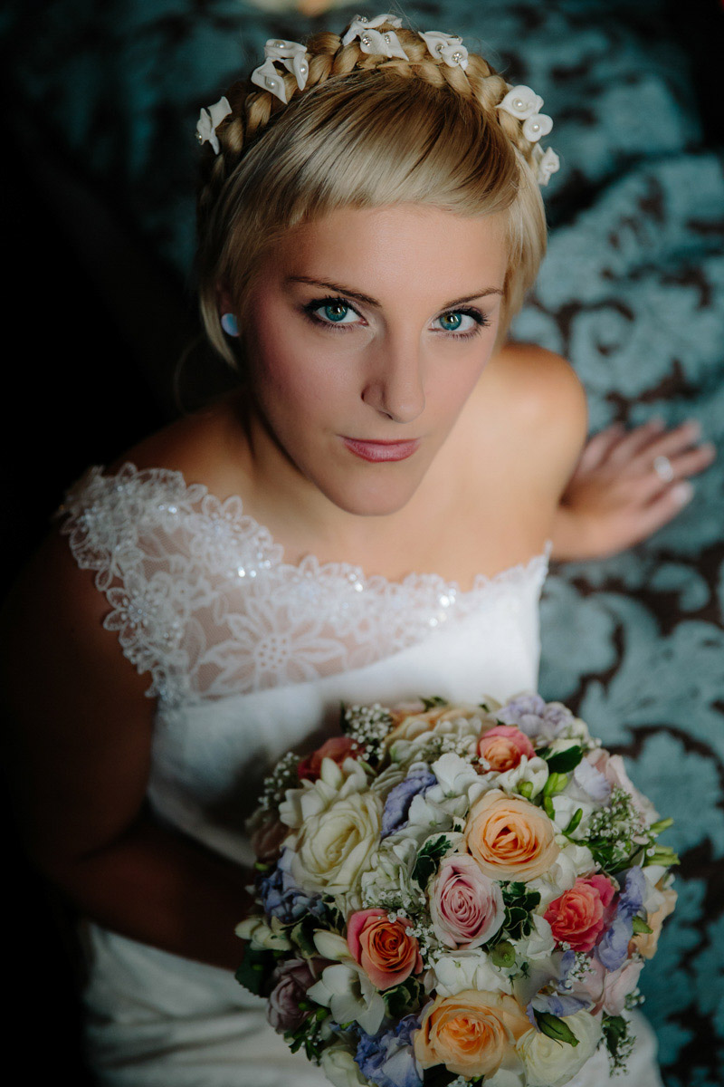 Bride during the bridal preparations with her bouquet