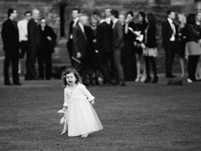 Flower girl running at Peckforton Castle in Cheshire