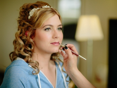 Bride having her make up done during the morning of the Bridal preparations