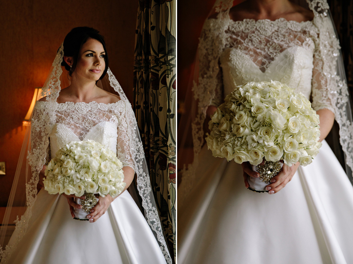 Beautiful bride in her wedding gown and white rose bouquet with silver broch