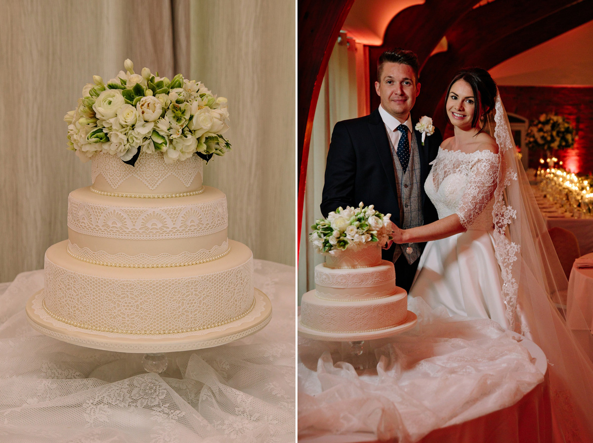 The Bride and Groom cutting their three tier wedding cake