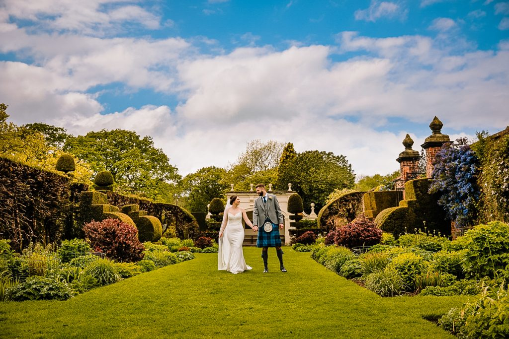 Bride and Groom photographed walking in the stunning gardens at Arley Hall and Gardens