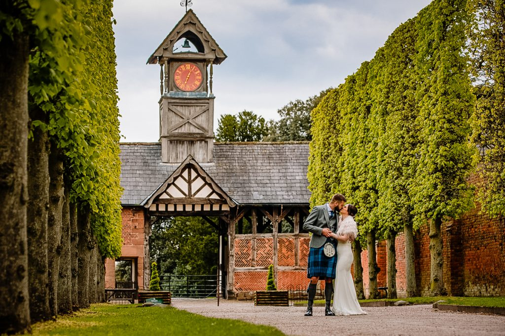 Bride and Groom at the Arley Hall clock tower
