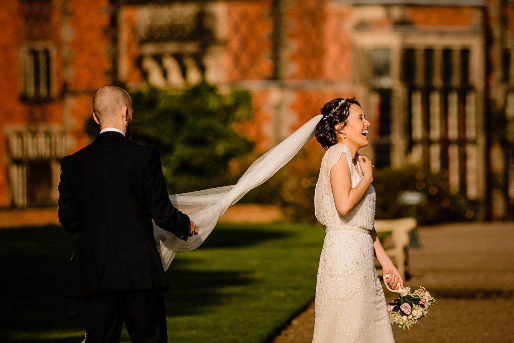 Bride and groom laughing at Arley Hall wedding