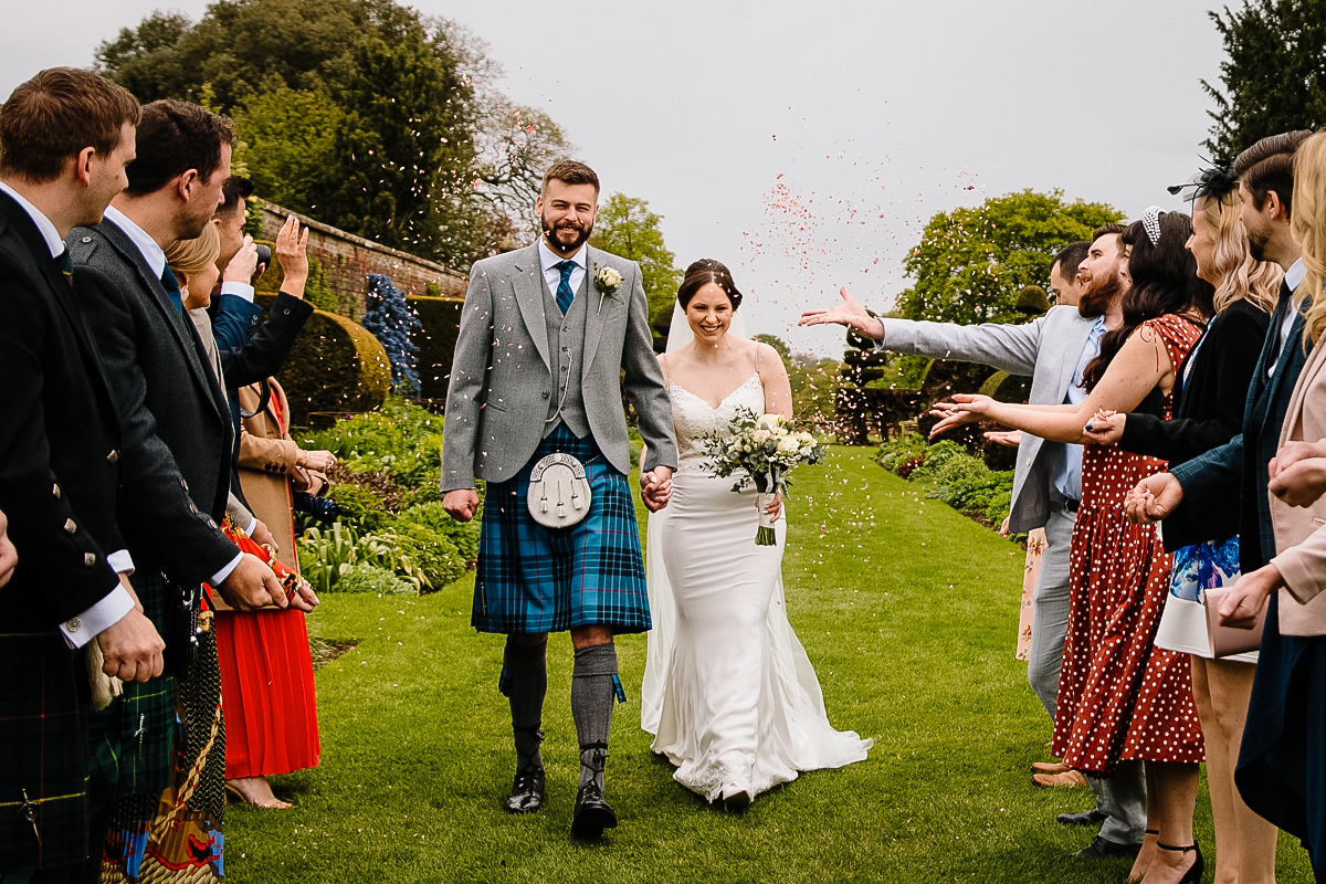 Arley Hall couple having confetti thrown at them in the stunning gardens