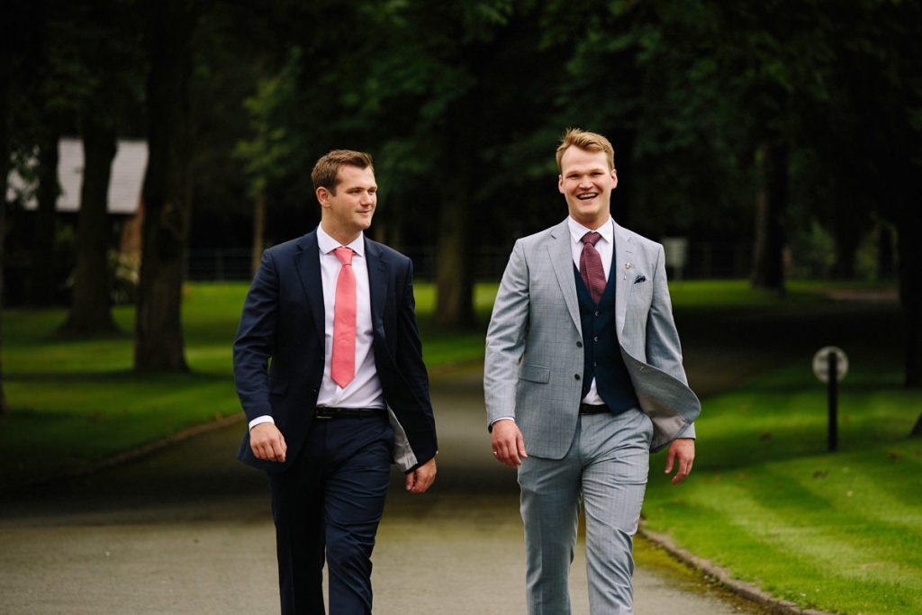 Groom and best man on the way to their wedding