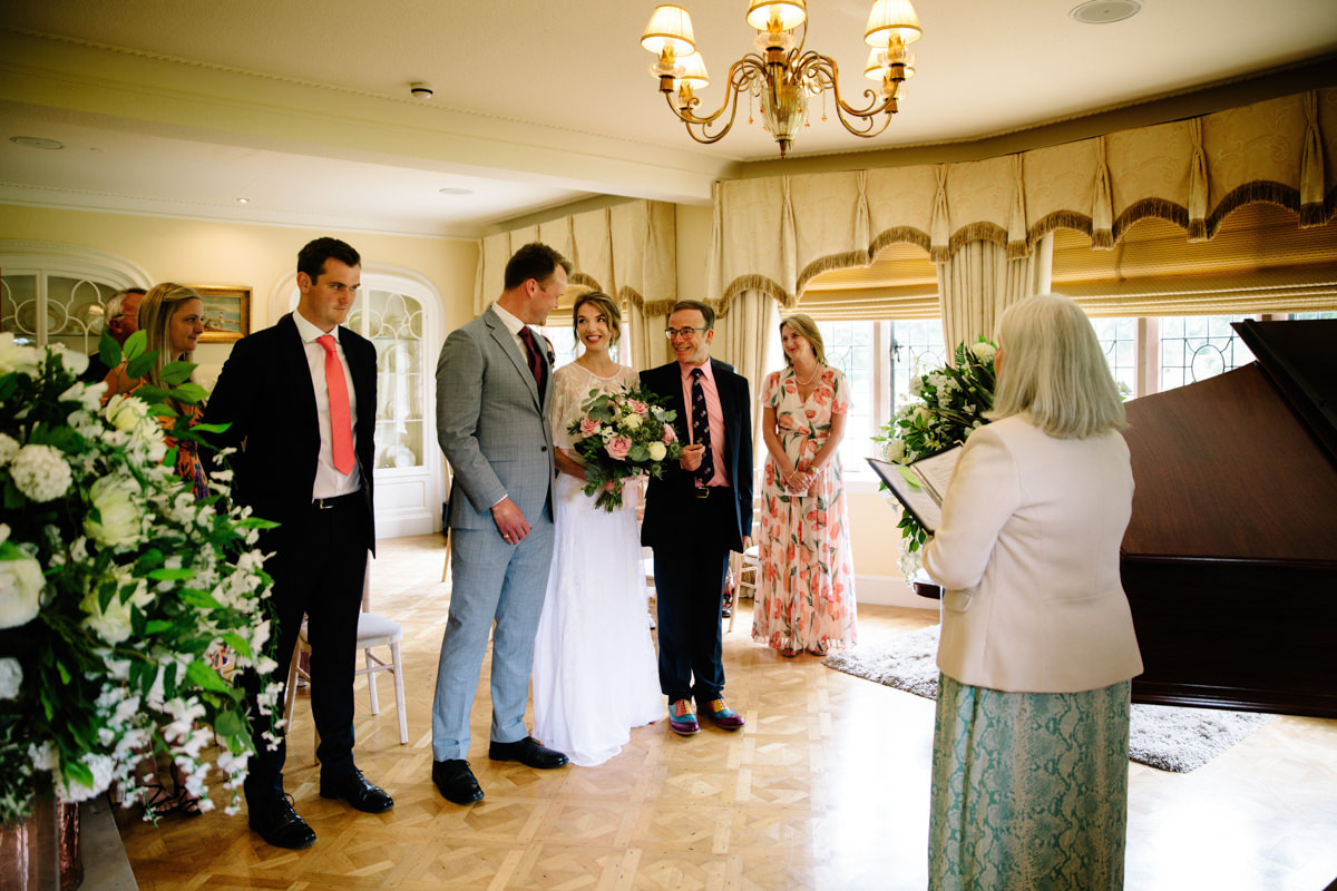 Groom seeing his bride for the first time at Colshaw Hall