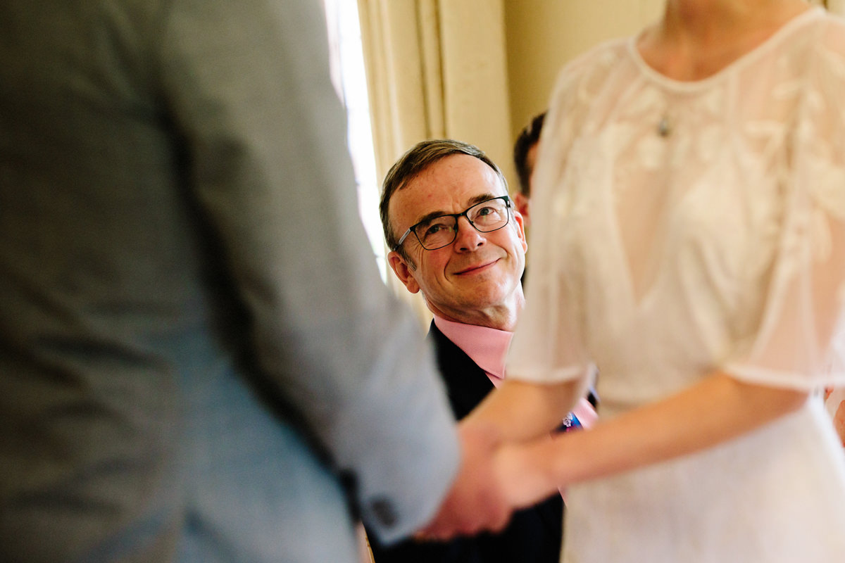 Father of the bride watching his daughter during the ceremony at Colshaw Hall