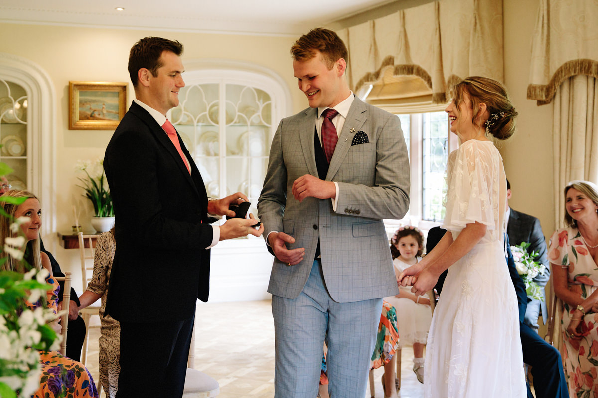 Best man hands over the wedding rings at Colshaw Hall