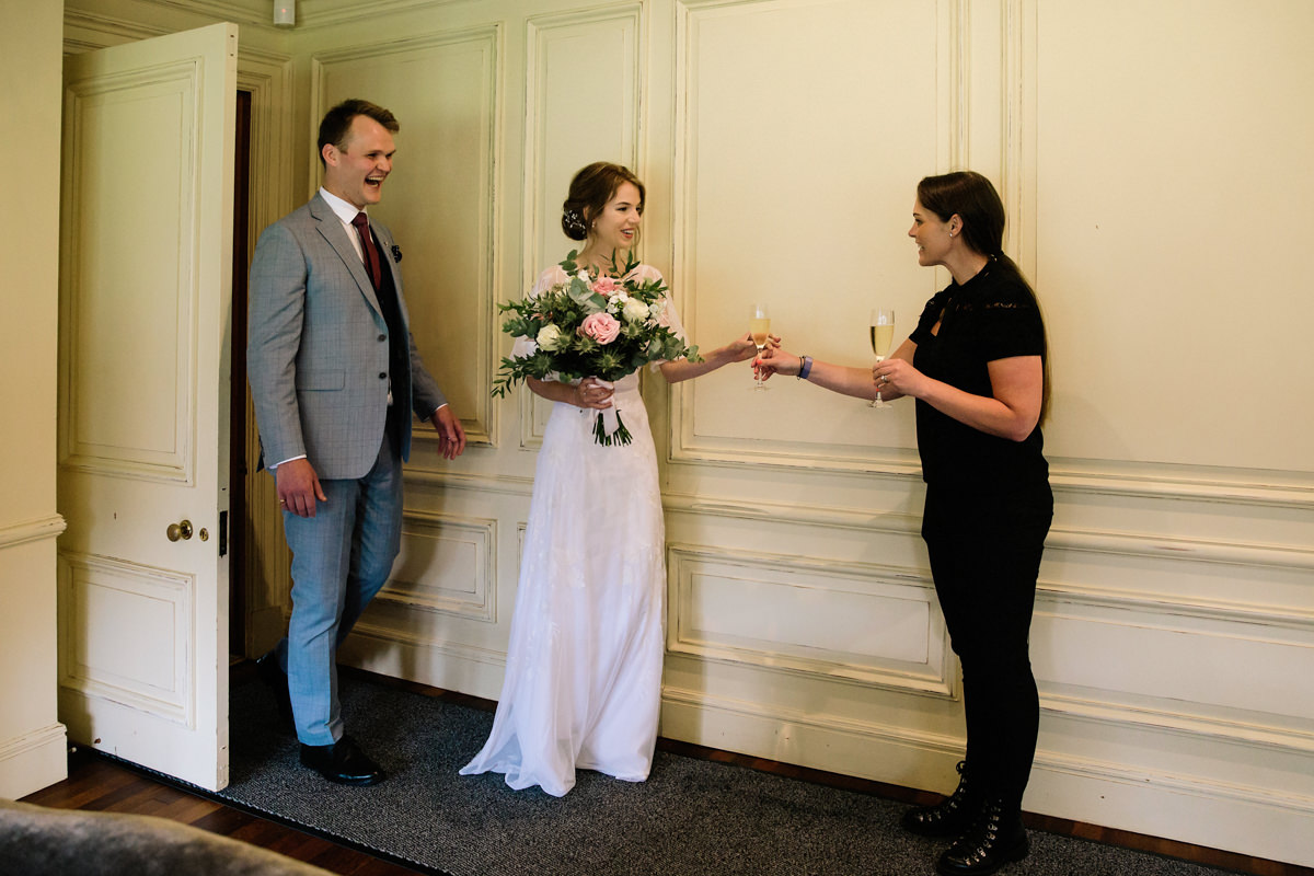 Shelly from Colshaw Hall welcomes the newly married bride and groom with drinks