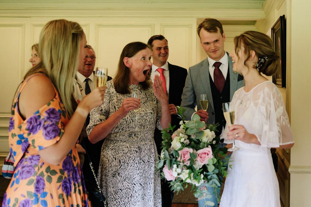 Guests congratulate the newly married couple