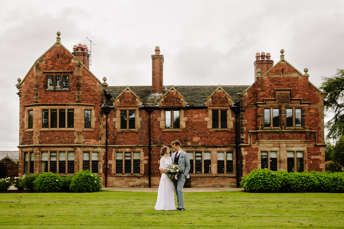 Bride and Groom in front of Colshaw Hall at their wedding