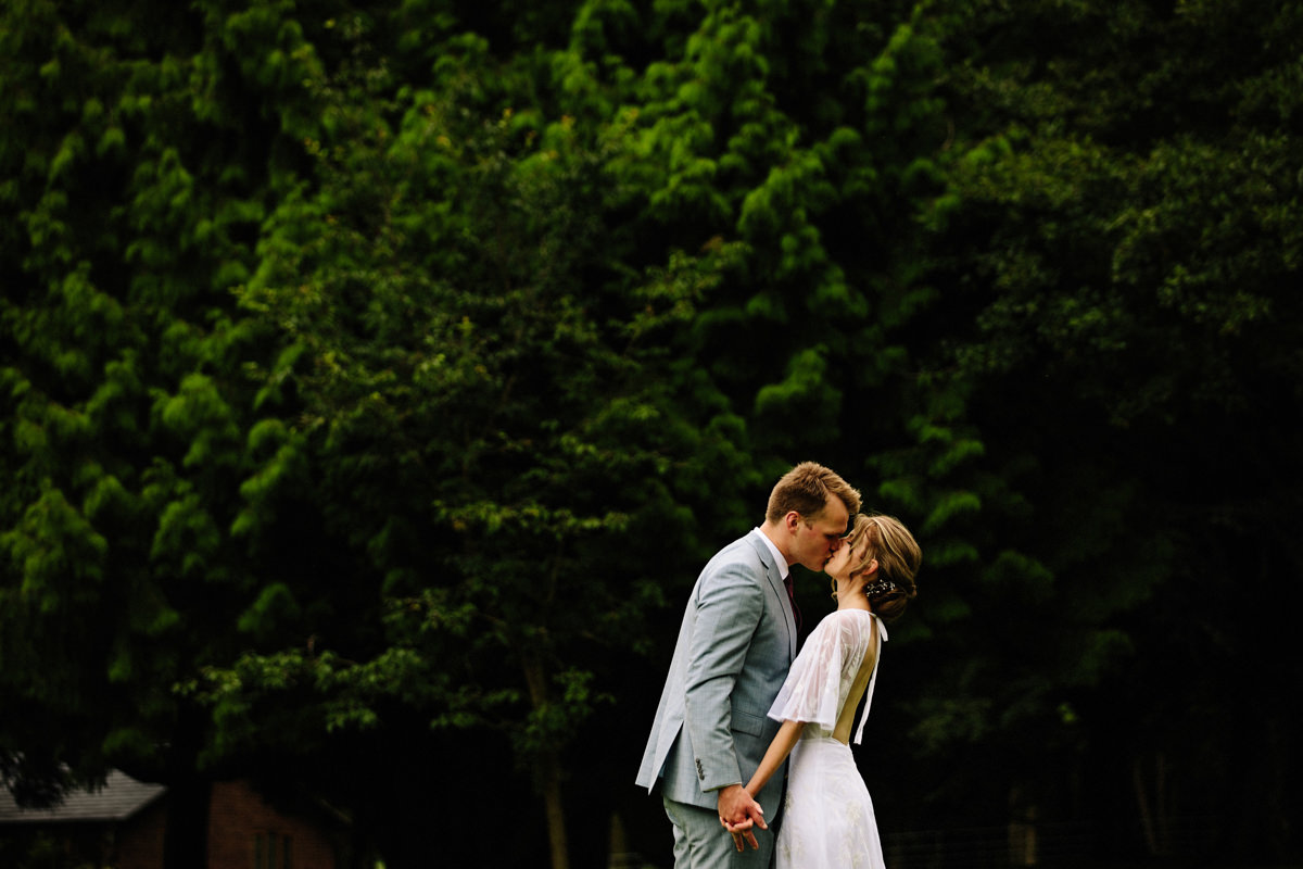 Intimate kiss between the bride and groom at Colshaw Hall wedding