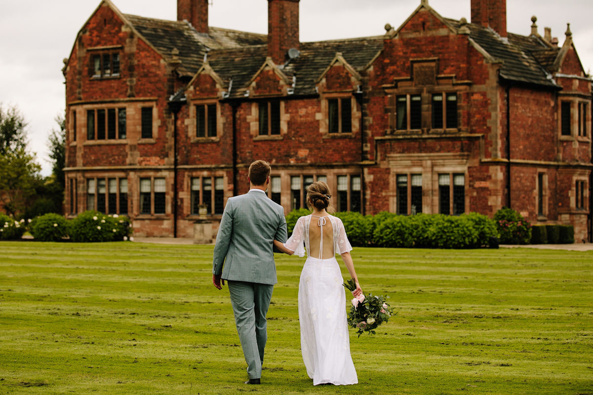 Colshaw Hall wedding photo with the bride and Groom walking