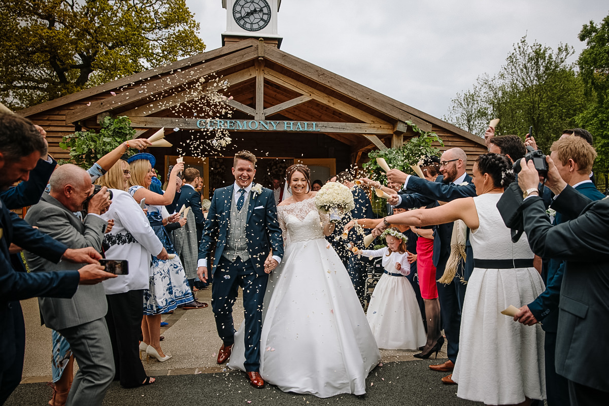 Fun Confetti Photo of the Bride and Groom at Colshaw Hall in Cheshire