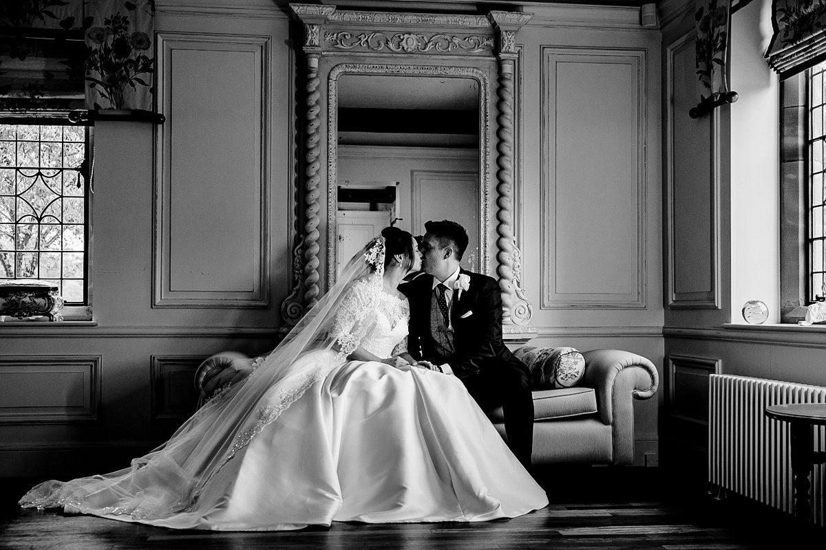 Black and white wedding photograph inside Colshaw Hall of the Bride and Groom