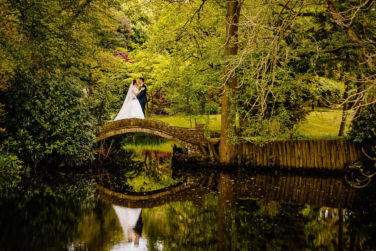 Bridge and reflections at Colshaw Hall Japanese gardens