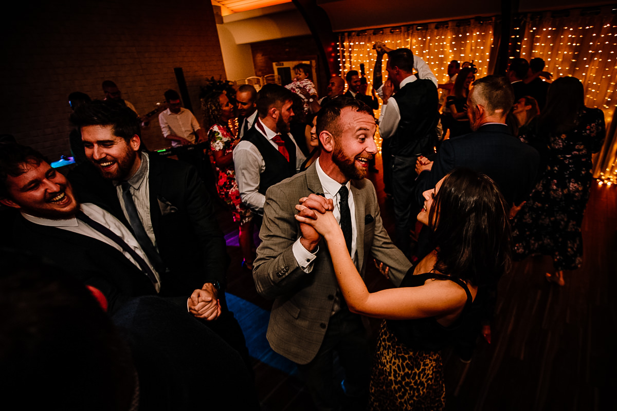 Partying and dancing at a wedding in Cheshire