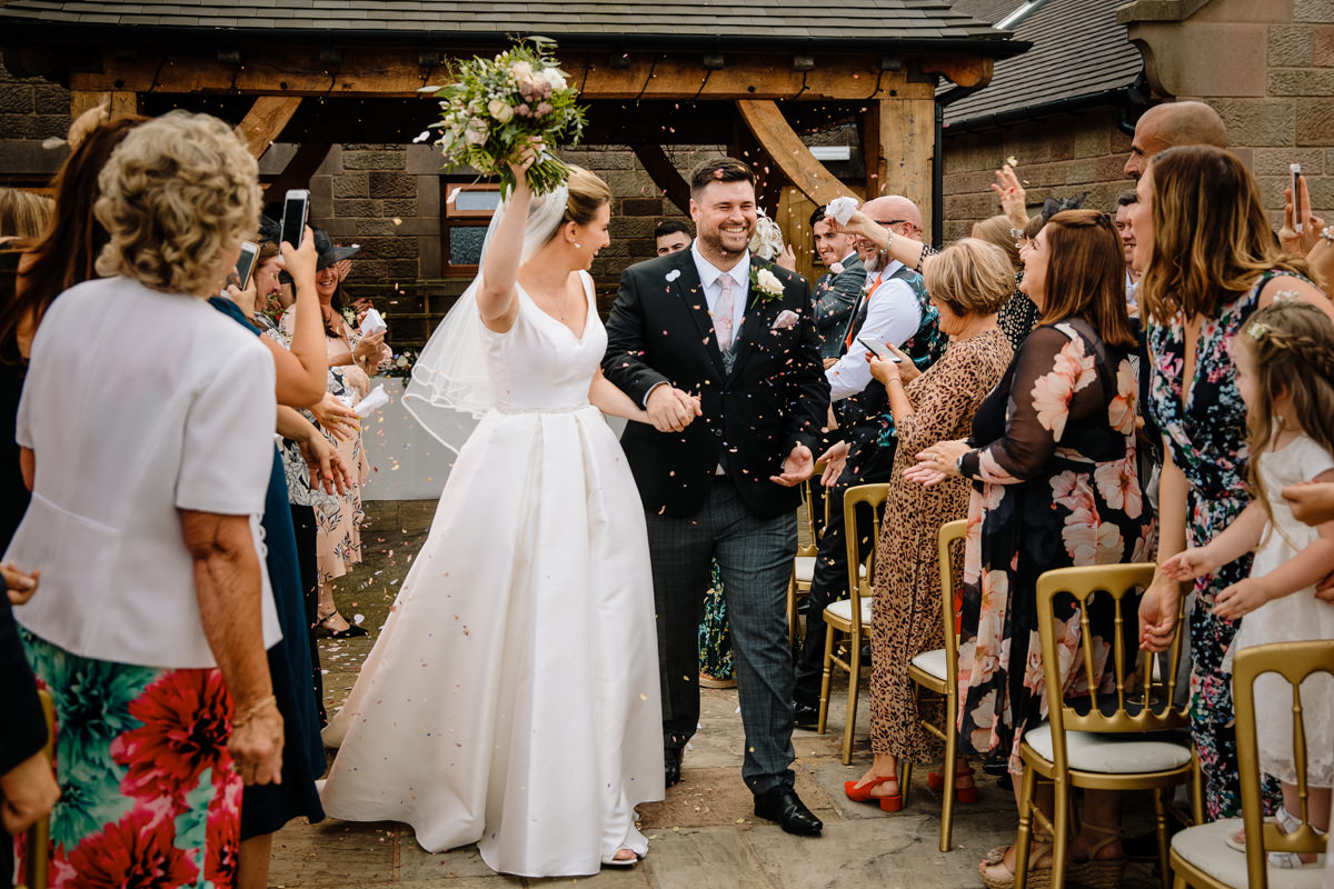 Bride and Groom getting married outside at the Oak Pagoda at Heaton House Farm