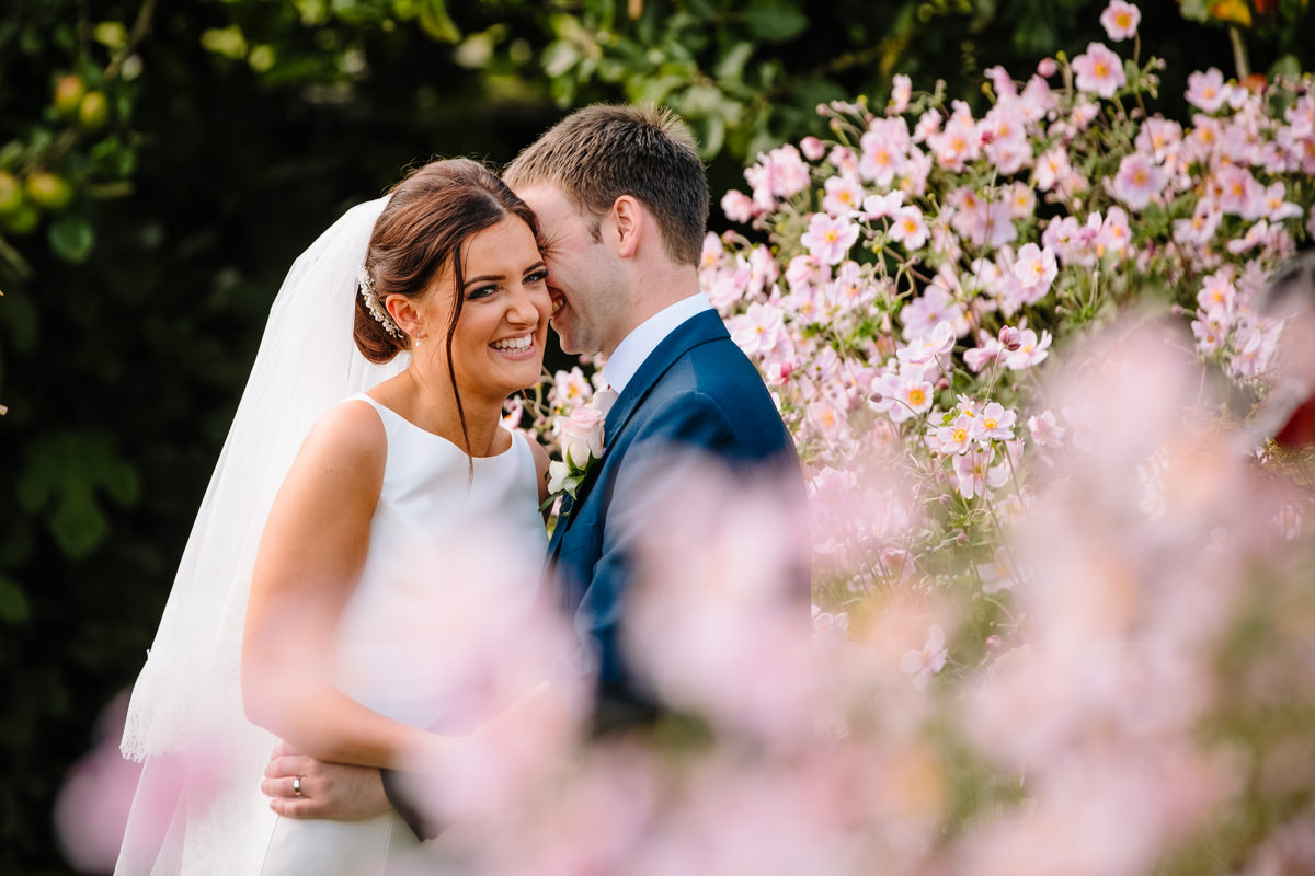 Bride and Groom with flowers at Heaton House Farm