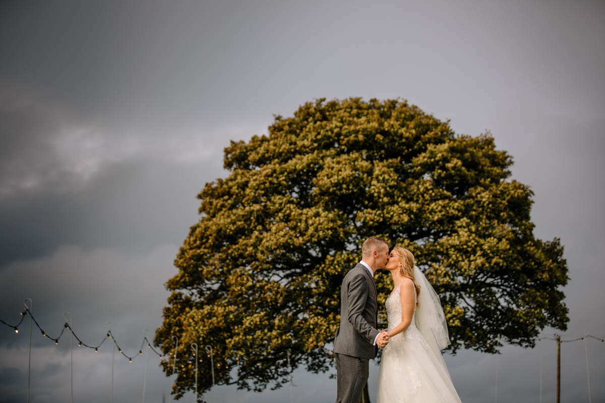 Bride and Groom and the Sycamore tree at Heaton House Farm