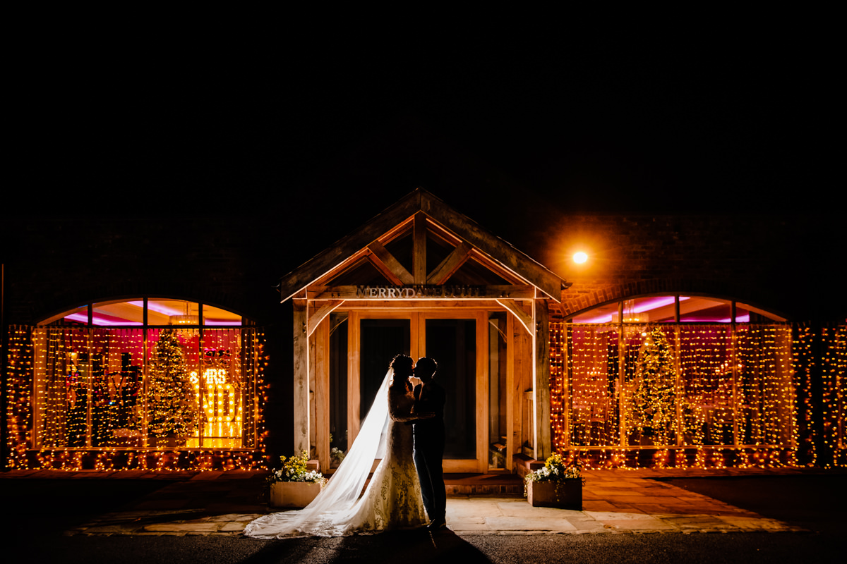 Merrydale Manor at night with fairy lights at Christmas, a lovely winter wedding