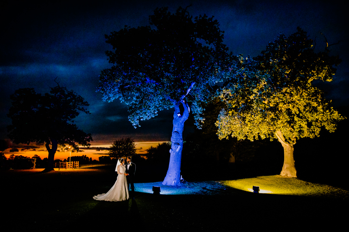 Creative night time photograph of the Bride and Groom at Merrydale Manor