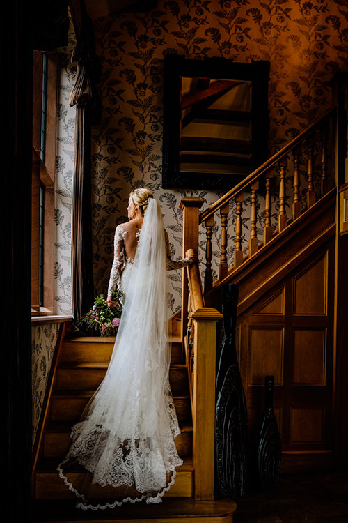 Bride on the stunning staircase at Merrydale Manor