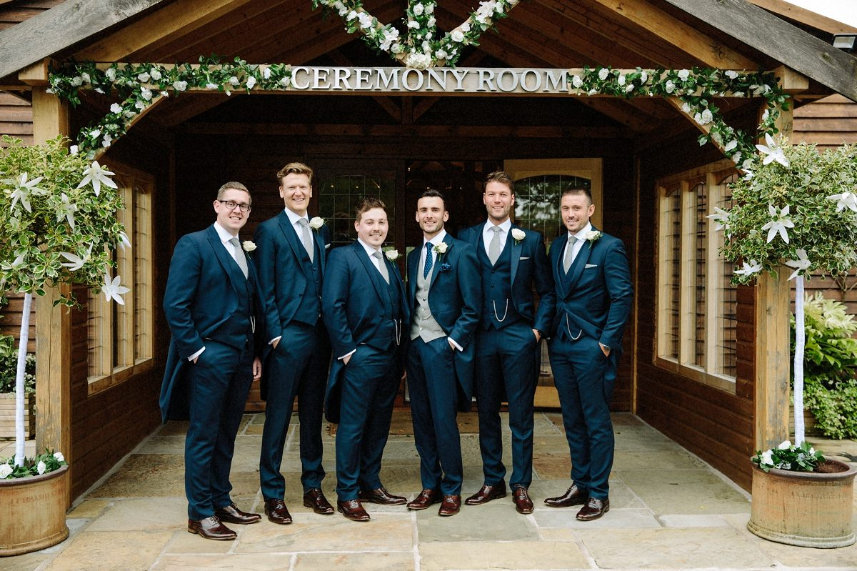 Groomsmen outside the ceremony room at Merrydale Manor