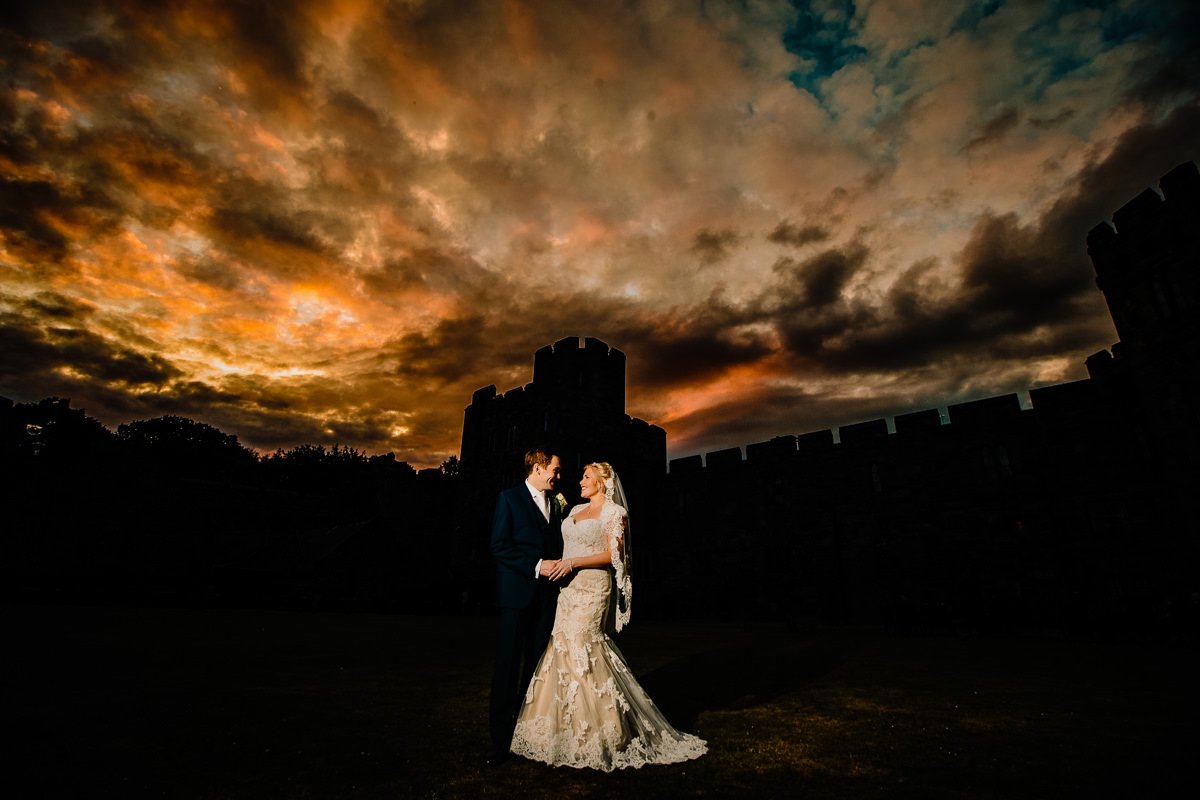 Sunset over Peckforton Castle with the bride and groom