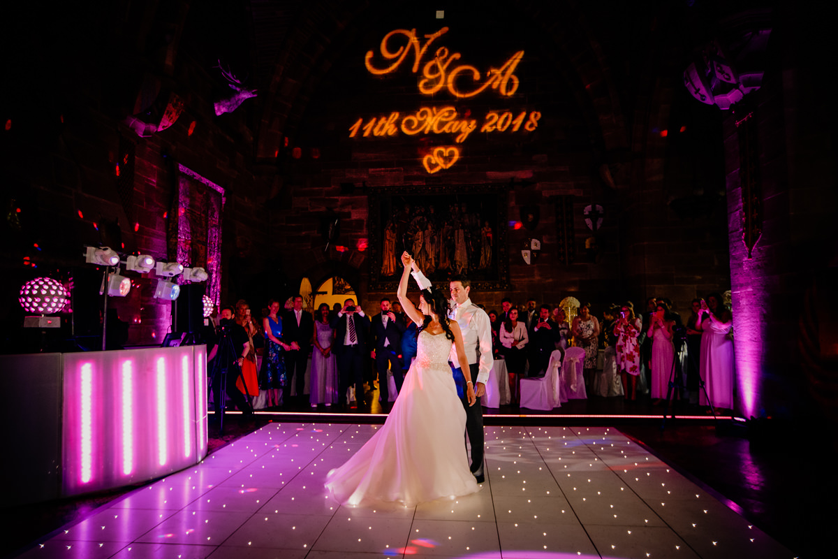 The first dance of the bride and groom in the great Hall at Peckforton Castle